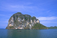Pier to island in Thai sea. Royalty Free Stock Photography