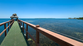 Pier to the ocean in florida Royalty Free Stock Photo