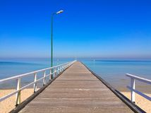 Pier to the sea in summer. A photo of a pier to the sea taken early morning in Seaford, Australia stock photography
