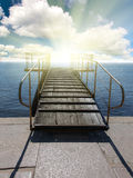 Pier to sunset Royalty Free Stock Photos