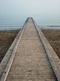 A pier towards the infinity. A pier towards of the infinity of the sea stock photography