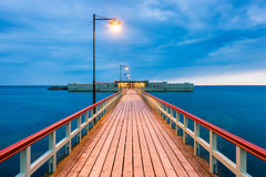 Pier towards Ribersborgs Bathhouse in Malmo Sweden at dusk Stock Image