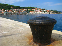 Pier and town - Croatian coast Stock Photos