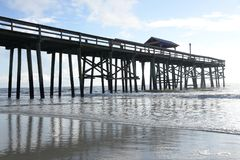 A pier is traditionally a gathering place for sportsmen to meet and have fun fishing for hours on-end. royalty free stock image