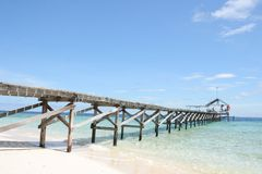 Pier at tropical beach Royalty Free Stock Image