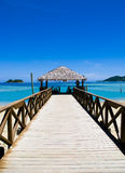 Pier on a tropical beach stock image
