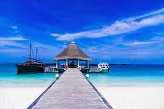 Pier on a Tropical Beach Stock Photos