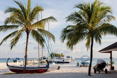 Pier on the tropical island. Boats, boats on the dock of a tropical island Stock Images