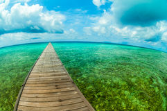 Pier in a tropical sea. Photographed with fisheye lens Stock Image