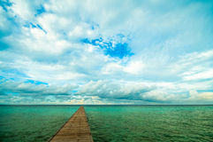 Pier in a tropical sea. Pier in a turquoise tropical sea Royalty Free Stock Photography