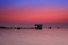 Pier in twilight. Fishing boat pier at dusk with beautiful twilight sky Royalty Free Stock Photography