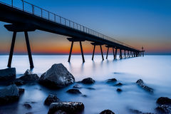 Pier at twilight. (long exposure Royalty Free Stock Photography