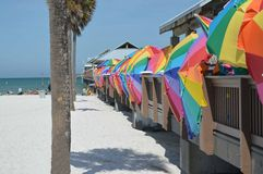 Pier of umbrellas. This is a photo of several multi-colored umbrellas lining a fishing pier royalty free stock image