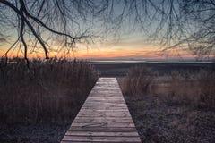 Pier und Sonnenuntergang Stockbild