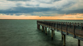 Pier Under Heavy Clouds Stockbild