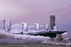 Pier under snow Stock Photos