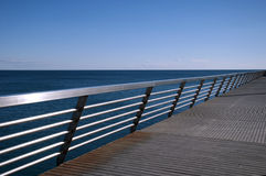 Pier. View of the pier and sealine on a beautiful day in Alicante, Spain royalty free stock images