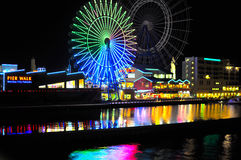 Pier Walk in Fukuoka, Japan. A ferris wheel and river's light reflections at premium factory outlet in the Pier Walk of Marinoa, Fukuoka Royalty Free Stock Images