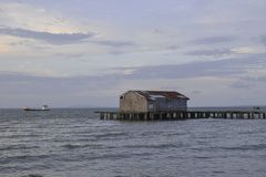 Pier warehouse in the beach at sunset royalty free stock image