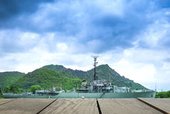 Pier and warship sailing into the sea for background usage Stock Photo