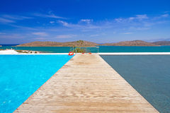 Pier at the water of Mirabello Bay. In Greece Stock Photo