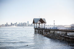 Pier overlooking downtown skyline. The pier at North Vancouver overlooking burrard inlet, Vancouver downtown Royalty Free Stock Photos