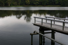 Pier at the waterside of the pond in the evening Royalty Free Stock Photo