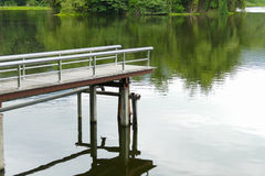 Pier at the waterside of the pond Stock Image