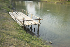 pier at waterside of pond Royalty Free Stock Photos