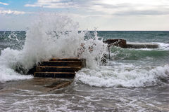 Pier in the waves Stock Images
