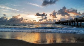 Pier and Waves. The Lake Worth fishing pier locate near Lake Worth, Florida Stock Images