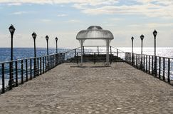 Pier with a wedding gazebo royalty free stock photography