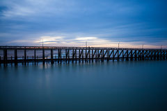The pier whit light pole at the sea Stock Image
