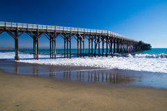 Pier winds into the Pacific ocean Royalty Free Stock Photography