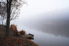 Pier on winter lake. Pier on winter foggy lake royalty free stock photos