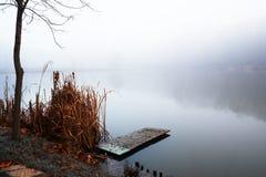 Pier on winter lake. Pier on winter foggy lake stock photos