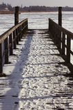 Pier in Winter on frozen Havel river Stock Photography