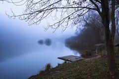 Pier on winter lake. Pier on winter foggy lake stock images