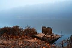Pier on winter lake. Pier on winter foggy lake stock image