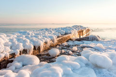Pier in the winter sea. ice, overcast, nature background Stock Images