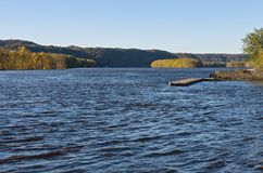 Pier and Wooded Banks of River at Prairie du Chien stock photo