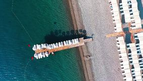 Pier. Wooden pier and turquoise water from above - shot from a drone stock footage