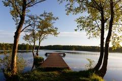Pier. Wooden pier at sunrise, lake Skoki, Poland Royalty Free Stock Photography