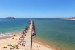 Pierce breakwater Marina of the city of Portimao. Cruise ship in background. Stock Photo