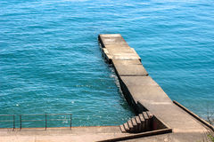 Pierce, the coast, stairs to the sea Royalty Free Stock Image
