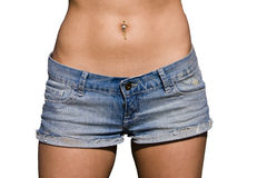 Pierced abdomen. Woman abdomen in jeans detail, isolated on white Stock Photos