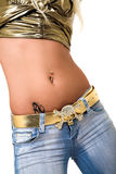 Pierced belly ring. Pierced belly and jeans isolated on white Royalty Free Stock Photography