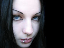 Pierced blue-eyed girl. Girl with piercing Royalty Free Stock Photography