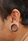 Pierced ear with big ring Stock Image