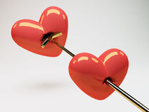 Pierced Hearts. A valentines background with a view of two red hearts pierced with a metallic arrow Stock Image